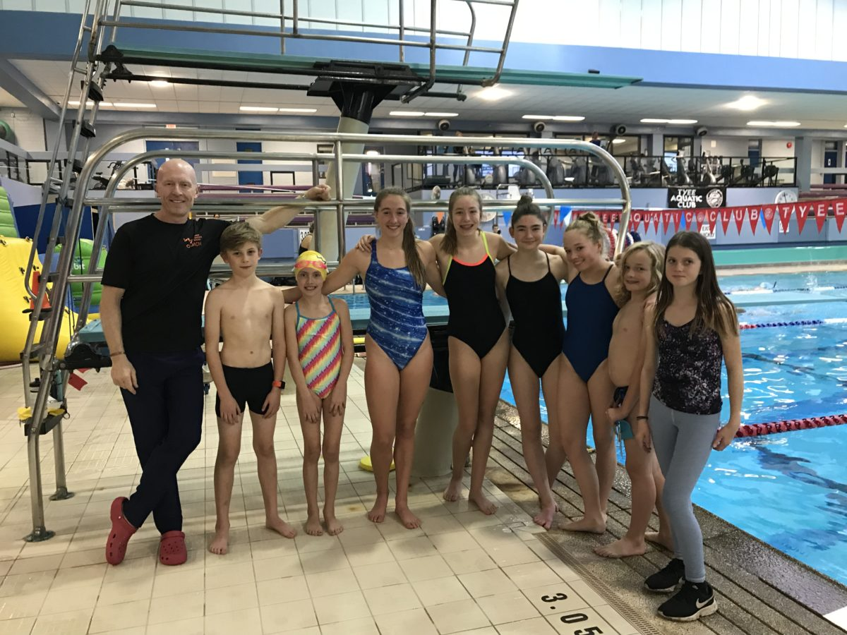 Youth swimmers on deck